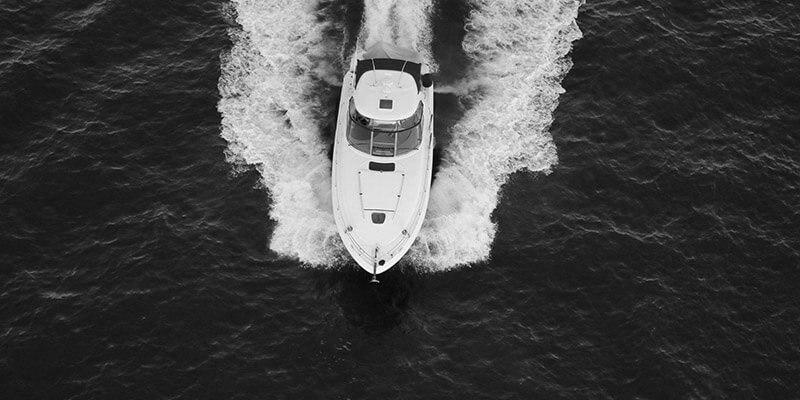Boat speeding across the sea