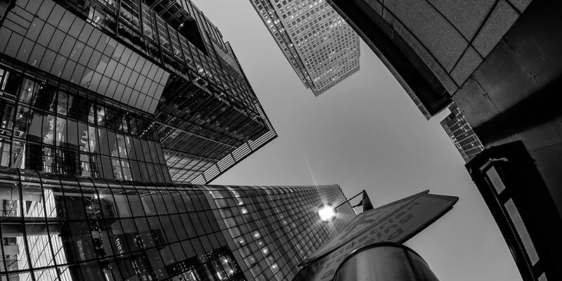 Looking up at a view to the top of high-rise buildings