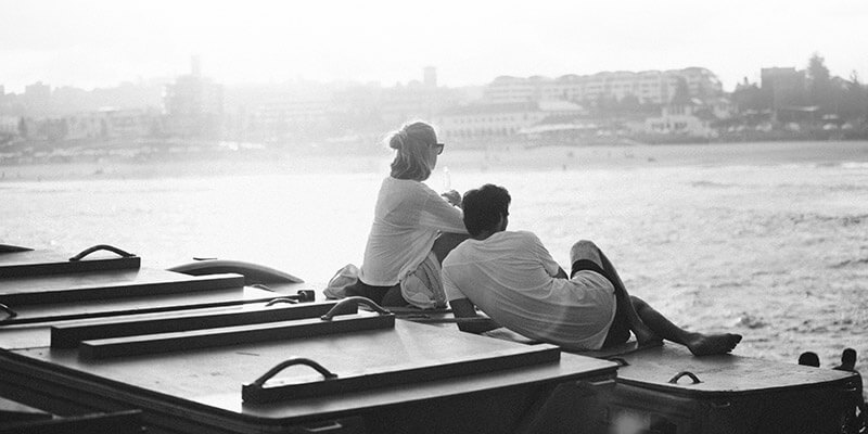 Relaxed couple looking across the ocean to shore