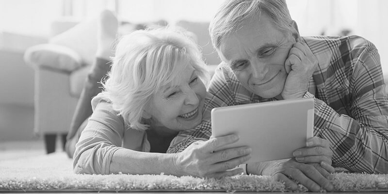 Happy retired couple looking at a document